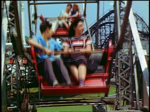1940s people on ferris wheel turning past camera / coney island, new york - coney island stock-videos und b-roll-filmmaterial