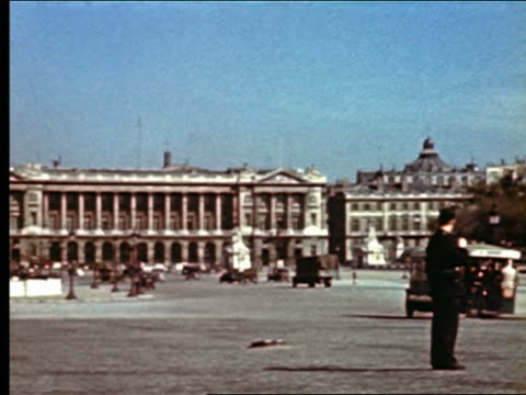 1940s PAN policeman directing traffic in Place de la Concorde / Paris, France