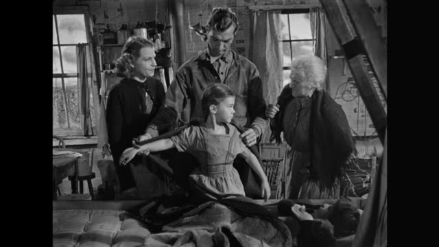 1940s poor father forcefully takes grandmother's blanket to make daughter's clothing - coat stock videos & royalty-free footage