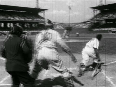 vídeos y material grabado en eventos de stock de b/w 1940s rear view black baseball player hitting ball running bases - oficial deportivo