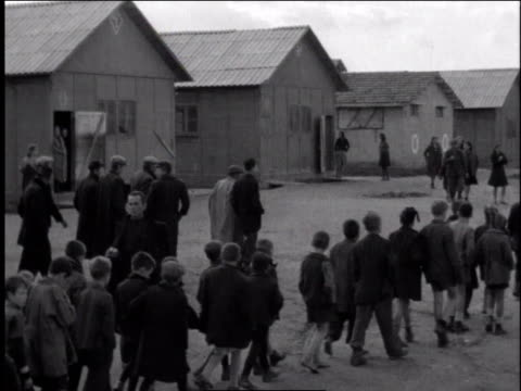 1940s ts refugees walking in a refugee camp / european theater of operations - refugee camp stock videos & royalty-free footage