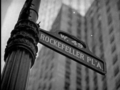 b/w cu la 1940s 'rockefeller plaza' sign at 'w. 49' street / new york city, new york - rockefeller center video stock e b–roll
