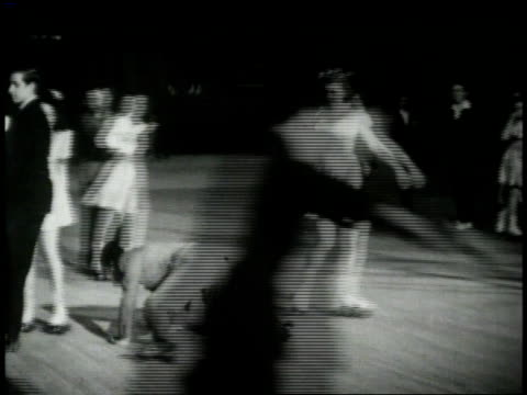 1940s roller skater tumbles and falls / united states - ice rink stock videos & royalty-free footage