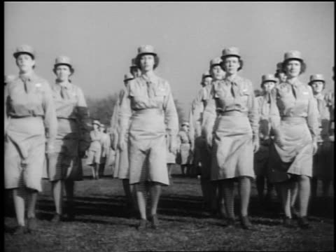 b/w 1940s rows of waac's in uniform marching in formation outdoors towards camera / documentary - womens army corps stock videos & royalty-free footage