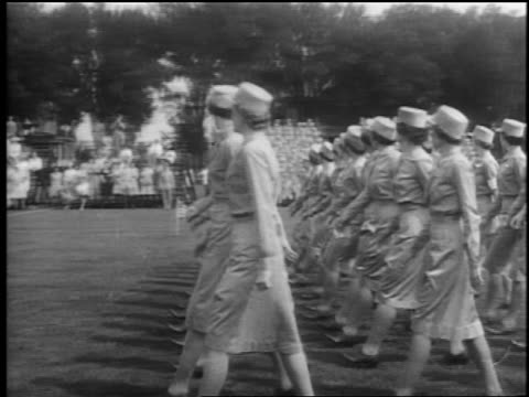 b/w 1940s pan rows of waac's in uniform marching in formation outdoors / documentary - womens army corps stock videos & royalty-free footage