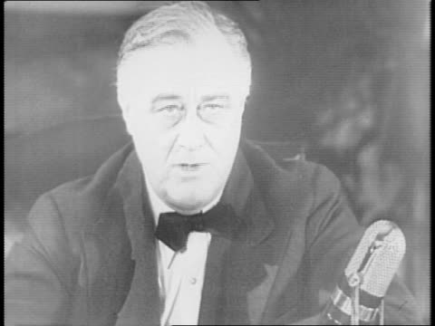 1940s sedan sits in snowy drive of white house / franklin delano roosevelt speaks into a microphone at a desk - sedan stock videos & royalty-free footage