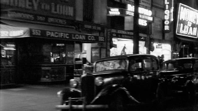b/w 1940s side car point of view driving past stores + burlesque theaters at night / los angeles - burlesque stock videos & royalty-free footage