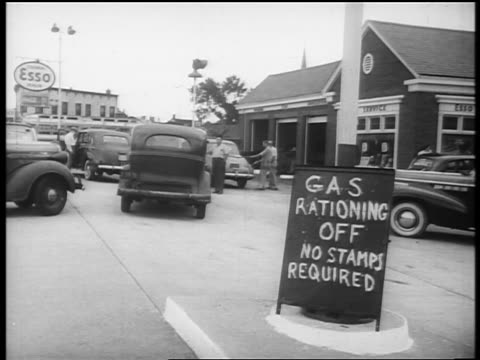 b/w 1940s sign at service station reading gas rationing off no stamps required/ newsreel - fuel crisis stock videos and b-roll footage