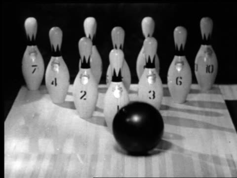 b/w 1940s slow motion close up bowling ball knocking down pins for strike - bouncing stock videos & royalty-free footage