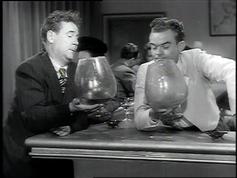 1940s spike jones and singers perform comical redition of 'cocktails for two' - wine glass stock videos and b-roll footage