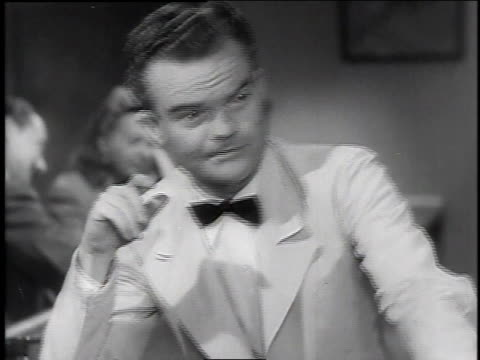 stockvideo's en b-roll-footage met 1940s ms spike jones sitting at bar / united states - uitfaden