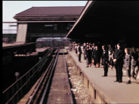 1940s subway train point of view pulling into outdoor coney island station with people waiting on platform - coney island brooklyn stock videos and b-roll footage
