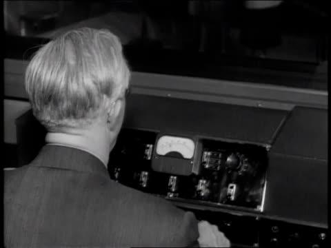 1940s tu technician operating the sound booth and conductor leading the band during an andrews sisters recording session / united states - inspelningsstudio bildbanksvideor och videomaterial från bakom kulisserna