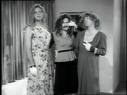 1940s MS three men in drag performing 'Cocktails for Two'