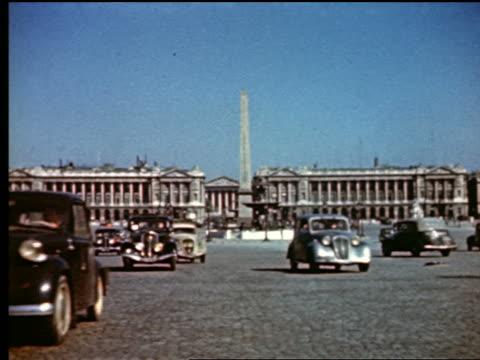 1940s traffic in Place de la Concorde / Obelisk + Hotel Crillon in background / Paris