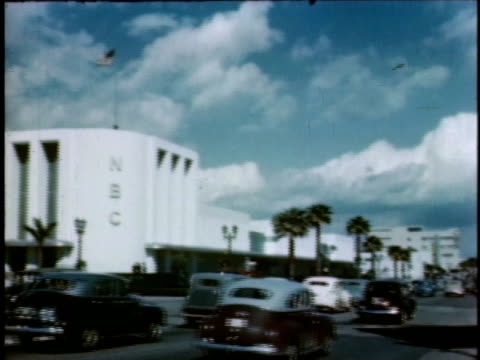 1940s WS traffic passing NBC building / Hollywood, California, United States