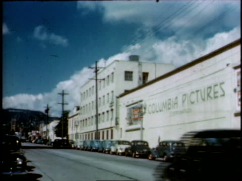 1940s WS traffic passing the Columbia Pictures Studios building / Hollywood, California, United States