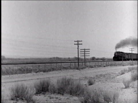1940s ws train speeding along tracks, belching black smoke - locomotive stock videos and b-roll footage