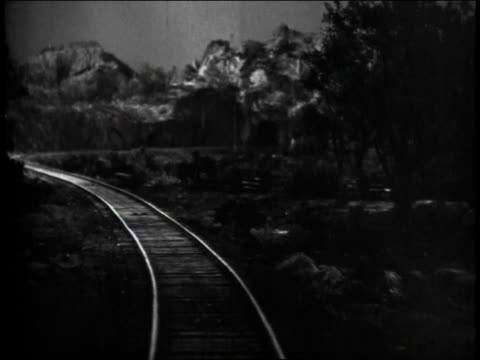1940s pov train traveling down winding tracks and running smack into the front of another train before retreating / united states - tramway video stock e b–roll