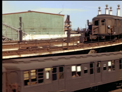 1940s pan two new york subway trains entering + leaving coney island / rides in background - coney island brooklyn stock videos & royalty-free footage