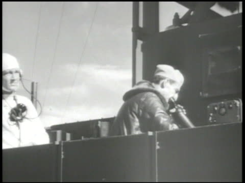 UNITED STATES NAVY MS US Navy officer on aircraft carrier deck talking into speaker receiver 'Standby to start engine stand clear of propellers start...