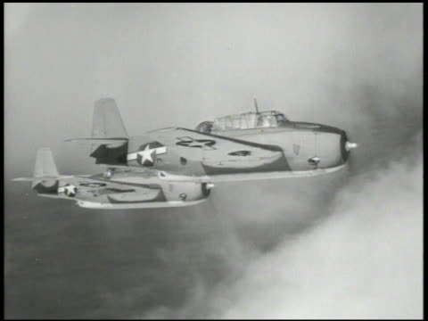 navy aircraft carrier ship in middle of pacific ocean flashing lights, signaling morse code. vs curtiss sb2c helldiver aircrafts flying, approaching... - air vehicle stock-videos und b-roll-filmmaterial