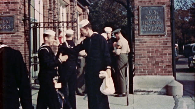 1940s us navy recruits receiving documents from sp officers while exiting gate at training station - military recruit stock videos & royalty-free footage