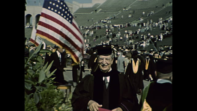 stockvideo's en b-roll-footage met 1940s usc graduation at the coliseum - home movie - diploma