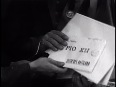 vatican city mail swiss guard walking out of post office holding packages oversized letters one addressed to pius xii official state mail packages... - swiss guard stock videos and b-roll footage