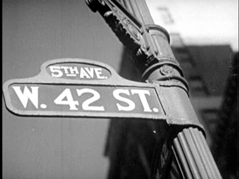 b/w cu la 1940s 'w. 42 st.' sign at 'fifth avenue' / new york city, new york - prelinger archive stock videos & royalty-free footage
