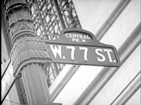 B/W CU LA 1940s 'W. 77 Street.' sign at 'Central Park W.' / New York City, New York