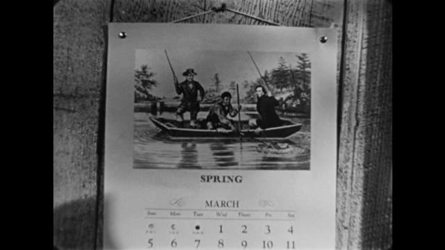 """1940s cu wall calendar depicting men in a boat with the words """"spring"""" and """"march"""" - the march of time stock videos & royalty-free footage"""