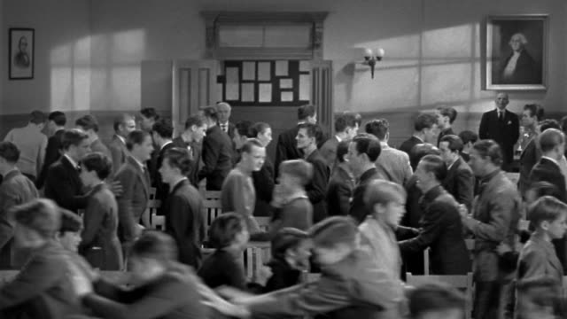 1940s wide shot group of boys standing in large classroom / leaving orderly lines / teacher in background - 50 59 years stock videos & royalty-free footage