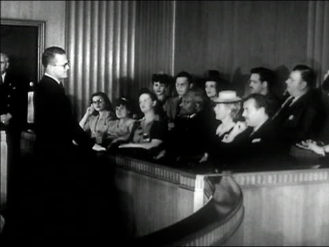 1940s Wide shot lawyer making case to jury/ AUDIO