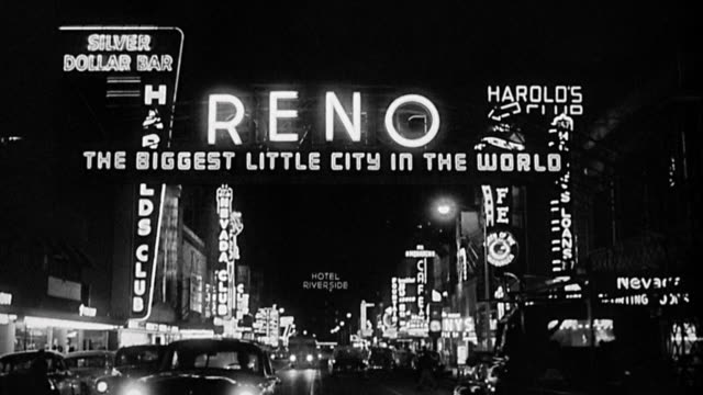 "1940s wide shot neon signs on casino strip for reno - ""the biggest little city in the world"" at night - casino sign stock videos & royalty-free footage"
