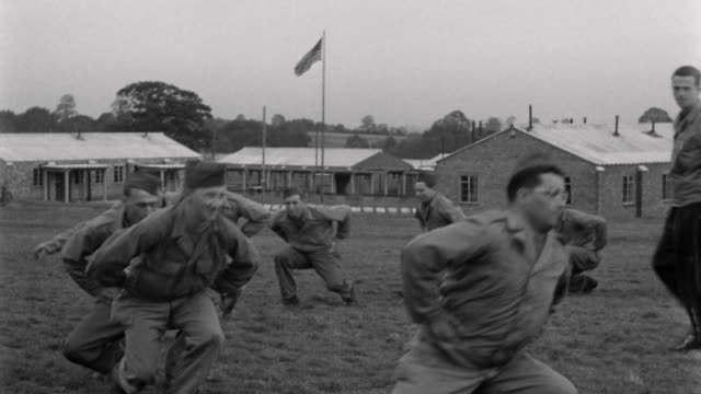 1940s wide shot soldiers walking in circle / squat walking in circle - army exercise stock videos and b-roll footage