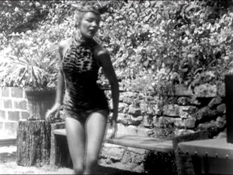 1940s Wide shot woman in tiger outfit dancing/ AUDIO