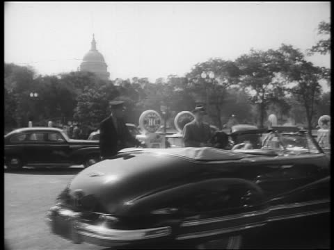 b/w 1940s woman in convertible pulling into gas station / capitol bldg in background / washington dc / news. - filling station attendant stock videos and b-roll footage