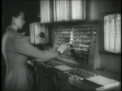 b/w 1940s woman operating early fax machine - fax machine stock videos & royalty-free footage