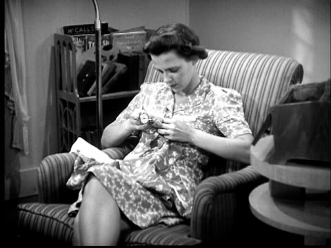 b/w montage 1940s woman sitting in armchair and sewing - 1940 stock videos & royalty-free footage