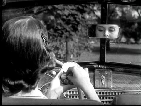 b/w montage 1940s woman sitting in convertible car and applying powder - 1940 stock videos & royalty-free footage