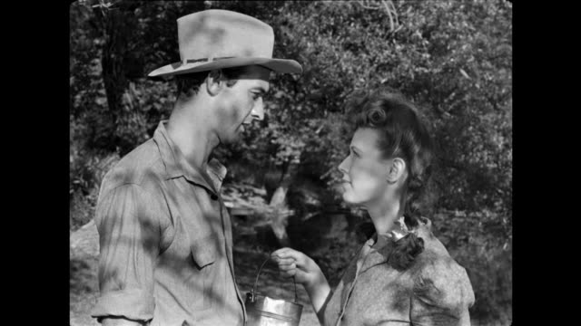 1940s woman tries to give a grateful man milk but is thwarted angry hillbilly brother - hillbilly bildbanksvideor och videomaterial från bakom kulisserna