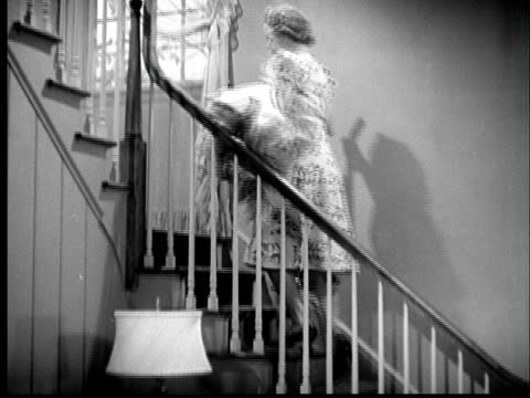 b/w montage 1940s woman walking up and down stairs, doing housework - steps and staircases stock videos & royalty-free footage