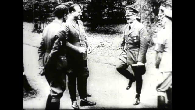 1940s WWII Adolf Hitler standing with other nazi officers laughing