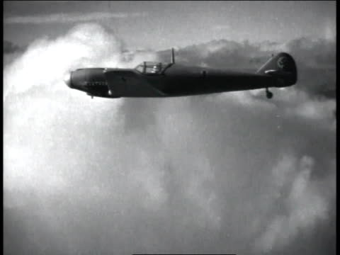 1940s ws wwii fighter plane flying above the clouds / united states  - 1945 stock videos and b-roll footage