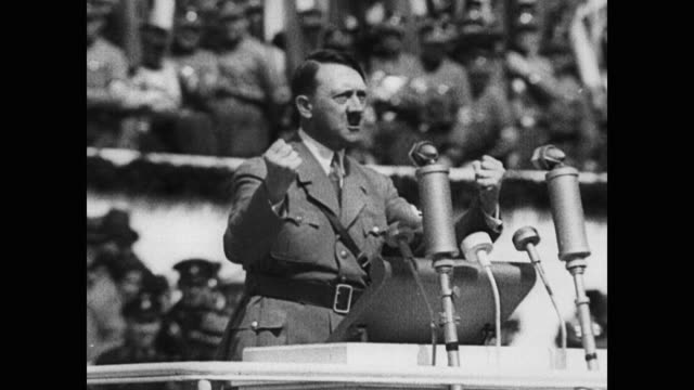 vídeos de stock, filmes e b-roll de 1940s wwii, nazis around the globe are united by adolf hitler's rousing podium speeches about the german race, the nazi third reich and the need for... - adolf hitler