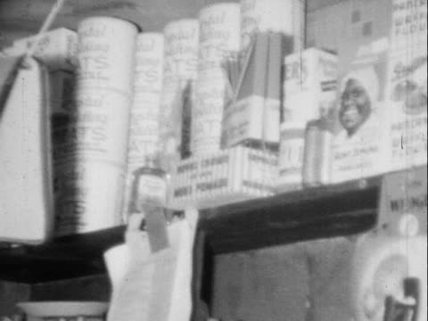 1940s/1950s MONTAGE B/W Customers and shopkeepers in grocery store, various grocery products on shelves/ Greenwood, Tulsa, Oklahoma, USA