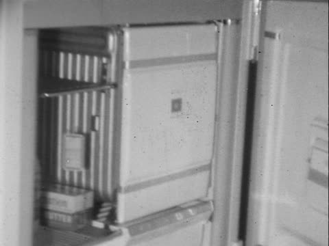 1940s/1950s montage b/w refrigerators and stoves for sale at a household appliance store/ customers shopping and salespeople working in store/ greenwood, tulsa, oklahoma, usa - 1940 stock videos and b-roll footage