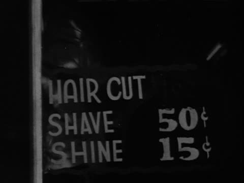 1940s/1950s montage b/w window sign for 'ideal barber shop'/ barber cutting customer's hair/ greenwood, tulsa, oklahoma, usa - barber shop stock videos & royalty-free footage
