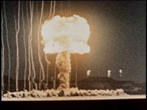 1940s/50s atomic bomb explosion at night / newsreel - radioaktiver niederschlag stock-videos und b-roll-filmmaterial